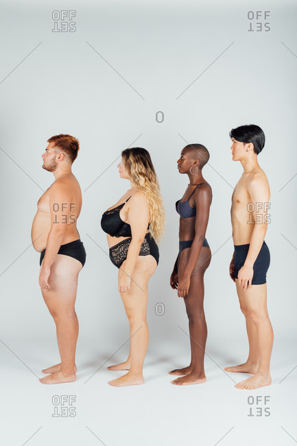 Young people wearing underwear, standing in a row