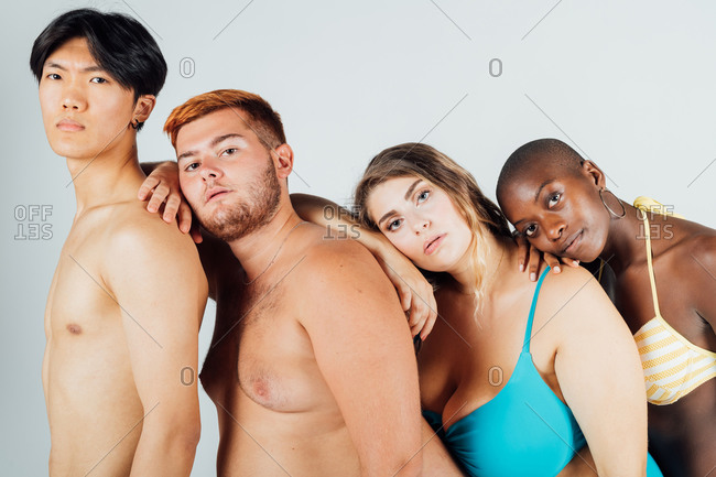 Young people leaning on each other