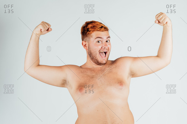 Young man with chest bare, flexing muscles