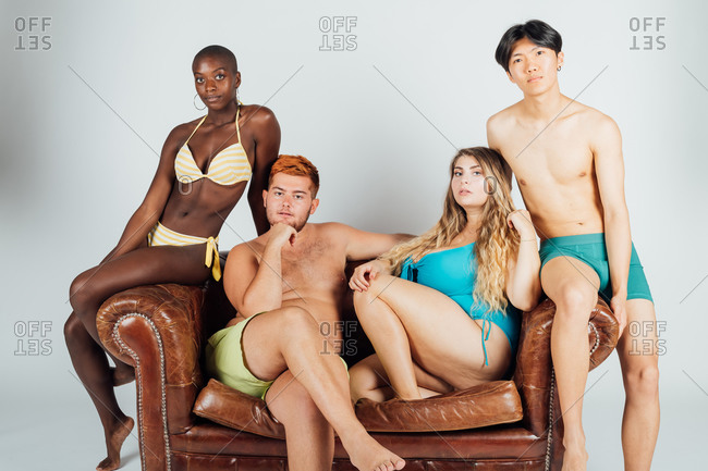 Portrait of young people on sofa in swimwear and underwear