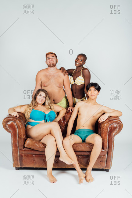 Four young people wearing underwear and swimwear