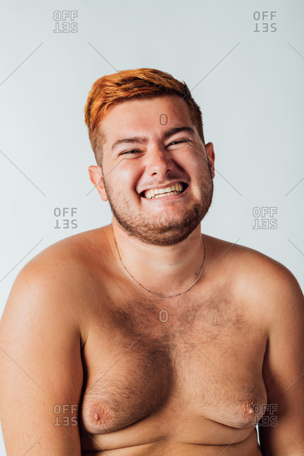 Portrait of a young man with bare chest, smiling