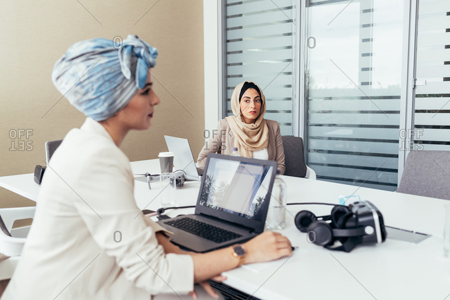 Female colleagues working in office