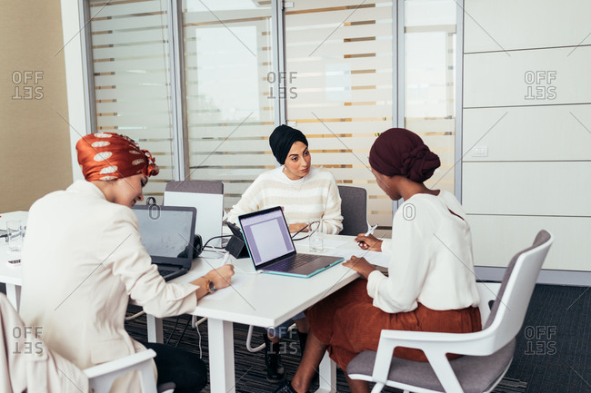 Female colleagues working together in office