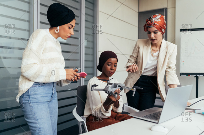 Female colleagues in office discussing drone