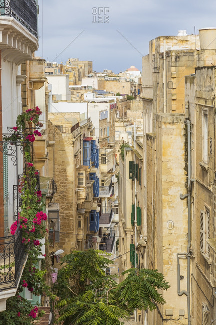 April 28, 2016: Old architectural apartment buildings with Maltese balconies, Valletta, Malta