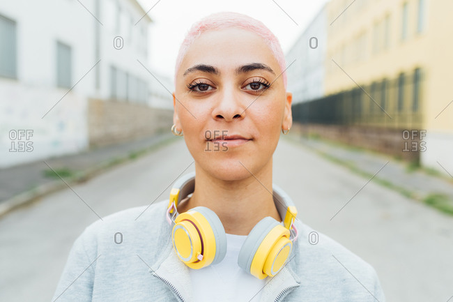 Head and should portrait of young woman with headphones