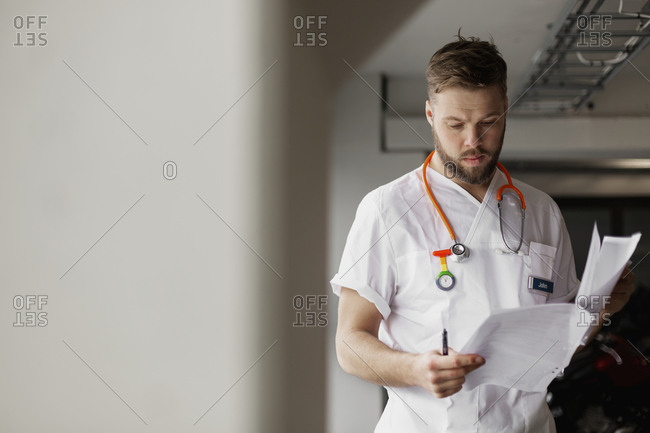 Doctor reading from medical records