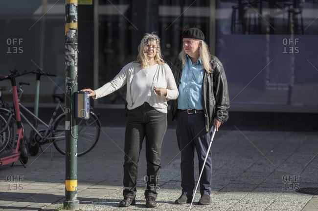 Senior couple standing at crosswalk