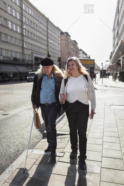 Senior couple walking in street