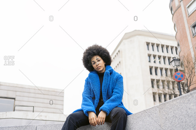 Young afro woman with expressive look looking at camera.