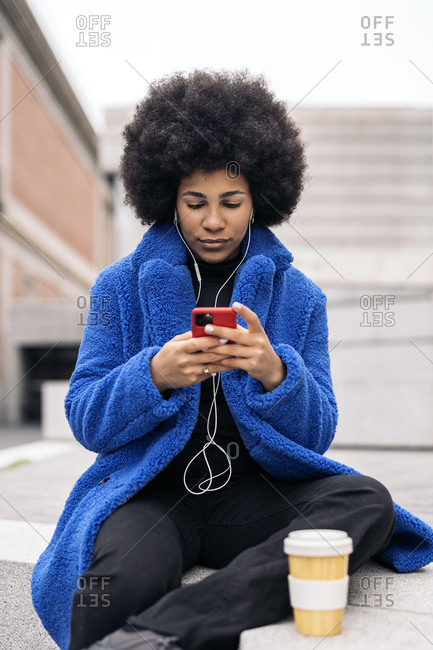 Beautiful african american girl using mobile phone in the city.