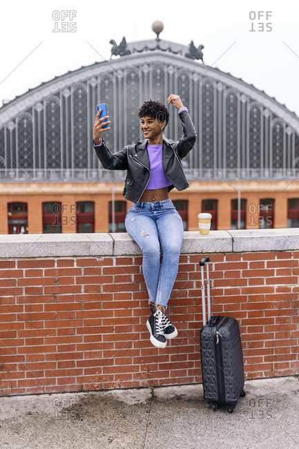 Beautiful african girl taking selfie in the streets of madrid.