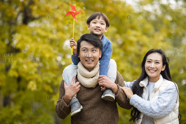 Happy young family having fun in woods