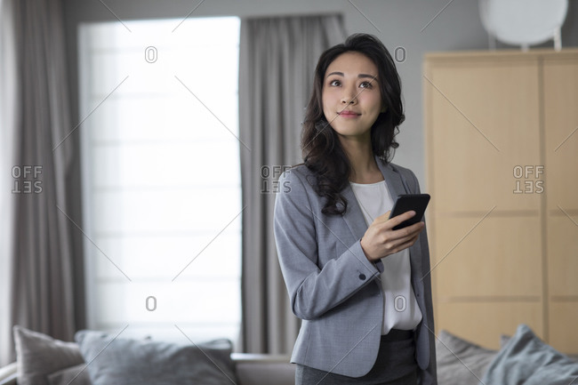 Young businesswoman and smart home