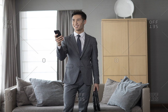 Young businessman and smart home