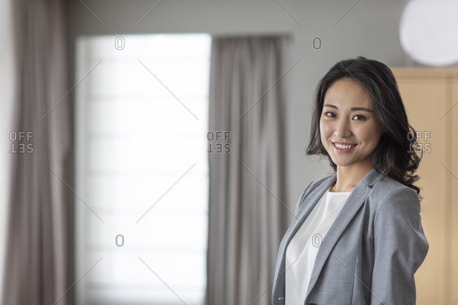 Young businesswoman in living room