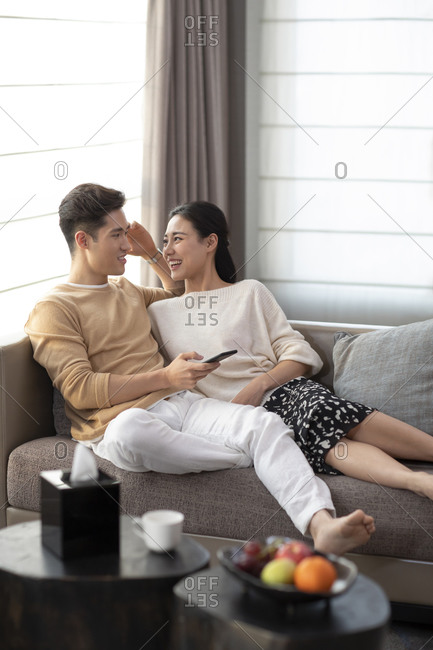 Happy young couple relaxing in living room