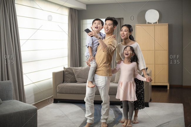 Young family and enjoying their smart home
