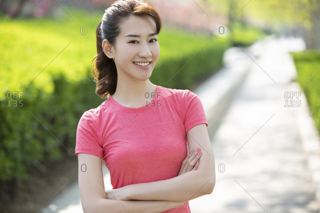 Happy young woman standing outside