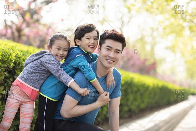 Happy young family playing in park
