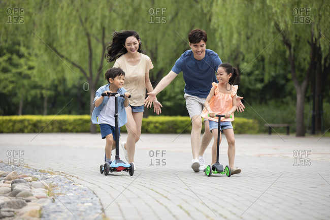 Happy young family having fun in park