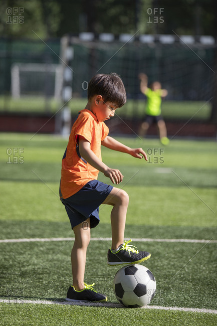 Children playing football on field