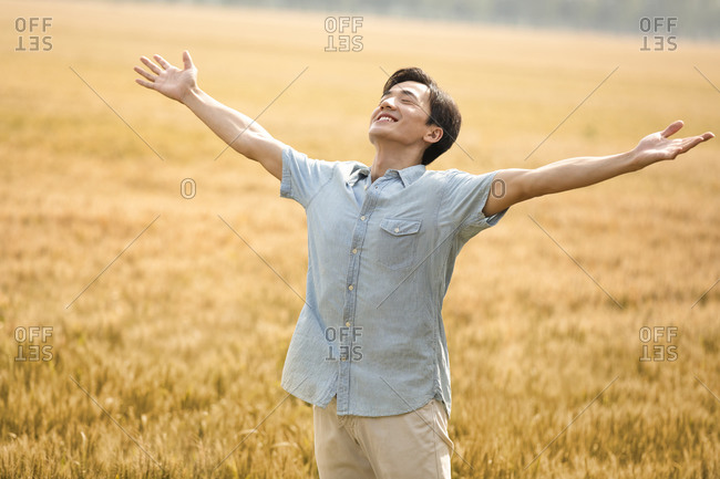 Happy young man in wheat field