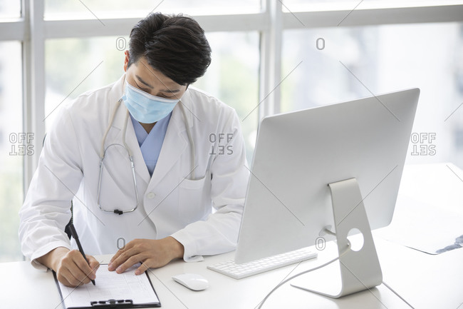 Young doctor working in doctor's office