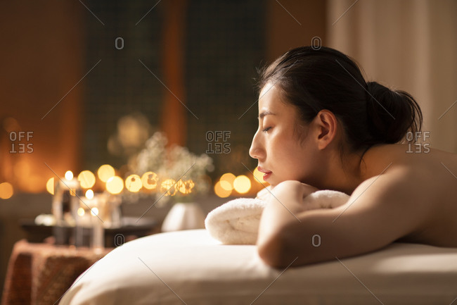 Beautiful young woman relaxing on massage table