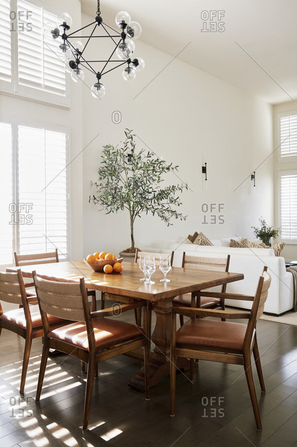 Studio City, California - January 3, 2021: Wooden table and chairs in dining room of a modern airy condo