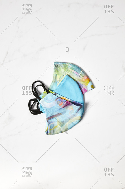 Colorfull cloth face masks on a white marble background