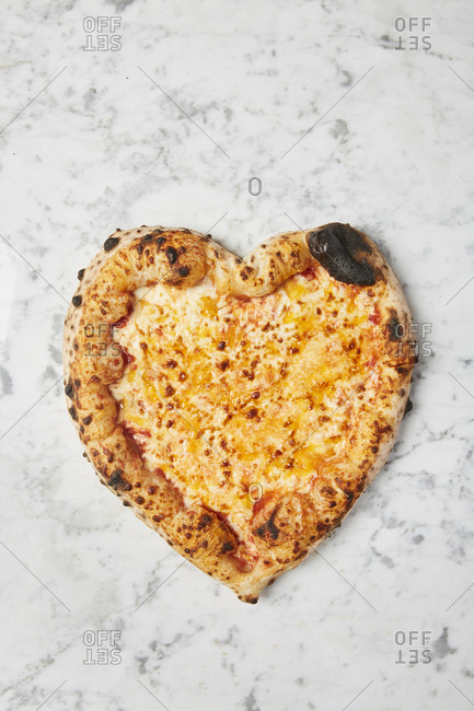 Overhead image of heart shaped pizza