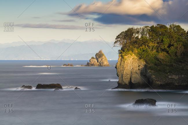 Long exposure shot of sea stacks and coastline in Izu Peninsula, Shizuoka Prefecture, Japan