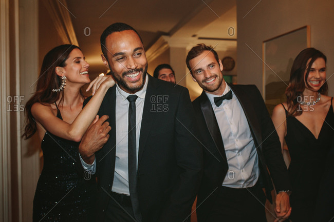 Diverse group of people at a party. Multi-ethnic friends having fun together at a gala event.