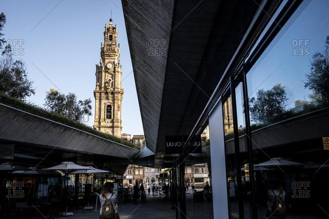 Porto, Portugal - August 29, 2020: Torre dos Clerigos bell tower seen from Praca de Lisboa