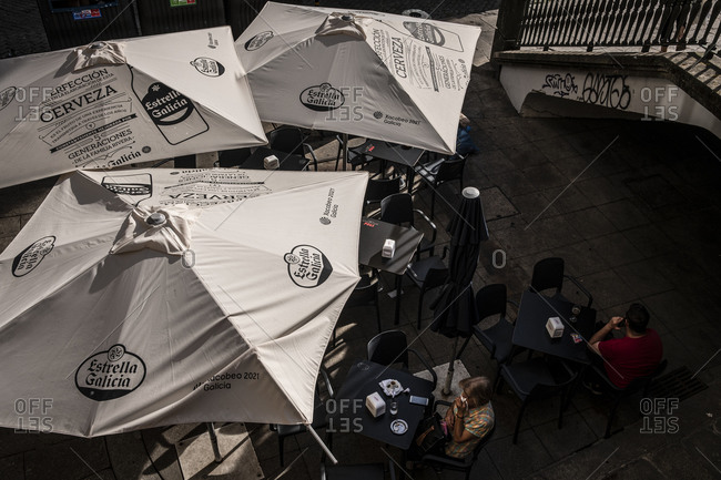 Porto, Portugal - August 31, 2020: Bird's eye view of people on a coffee terrace