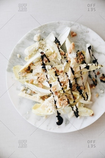 Endive salad with walnuts and blue cheese dressing