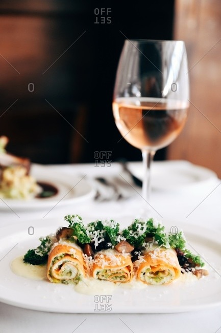 Crepes filled with organic chicken and mushroom, farro risotto, haricot vert, carrot, tarragon cream sauce served with wine