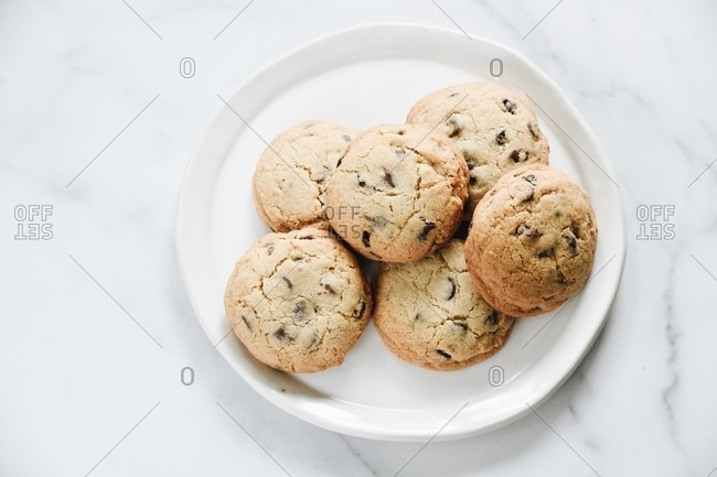 Chocolate chip cookies on plate on marble surface