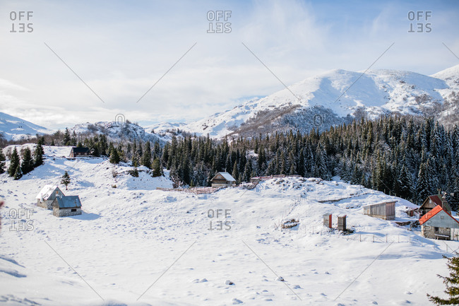 Snow-covered landscape with homes and forest in the Bjelasnica mountains in Bosnia and Herzegovina