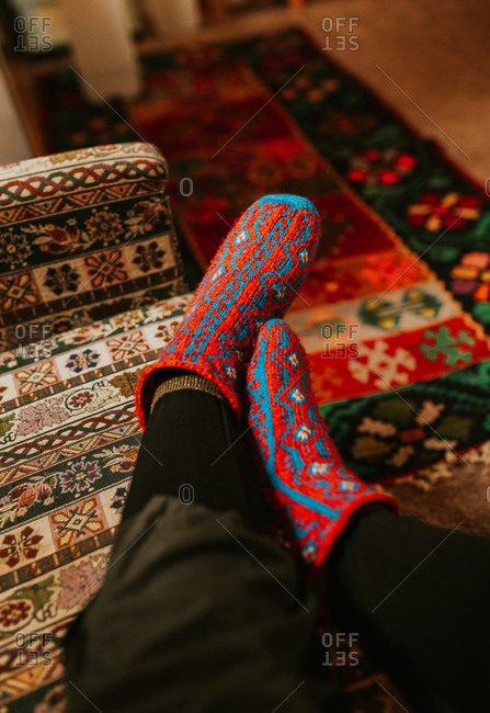Feet wearing comfy vibrant red and blue socks