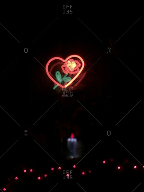 Isolated neon sign with heart and flower