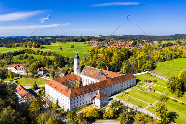 Germany- Bavaria- Dietramszell- Helicopter view ofDietramszellMonastery on sunny day