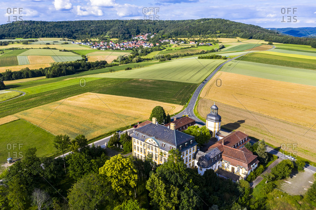 Germany- Bavaria- Eggolsheim- Helicopter view of Schloss Jagersburg and surrounding fields in summer
