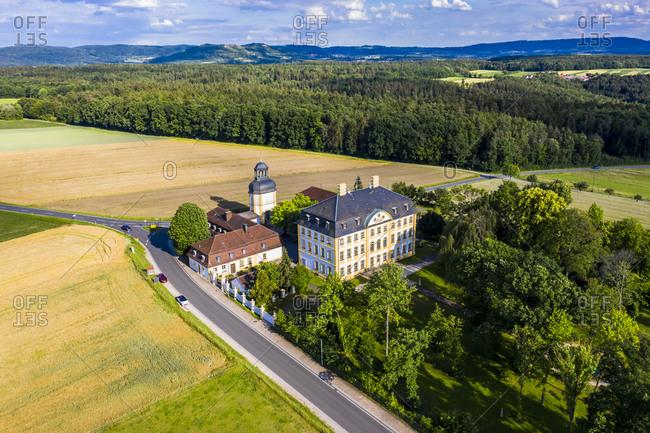 Germany- Bavaria- Eggolsheim- Helicopter view of Schloss Jagersburg in summer