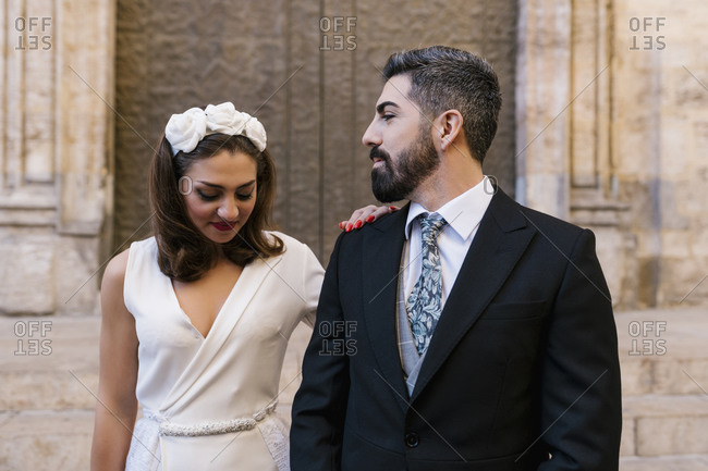Newly married couple against church