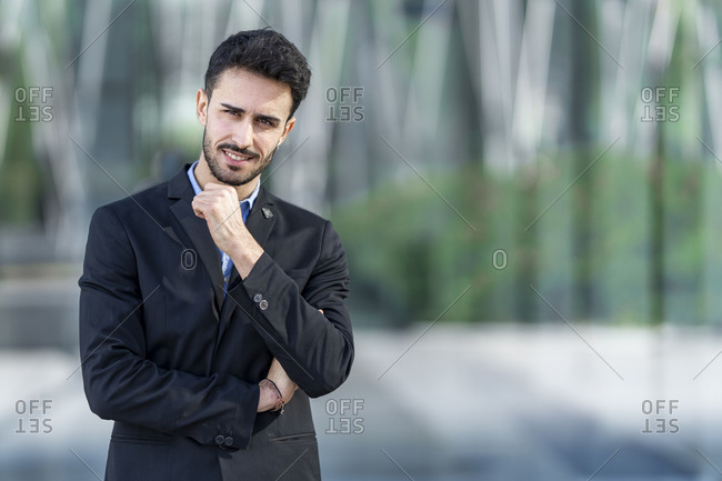 Businessman staring while standing outdoors