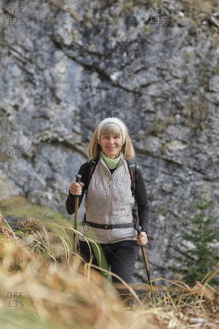 Portrait of senior hiker posing with hiking poles