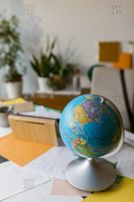 World globe with papers on table